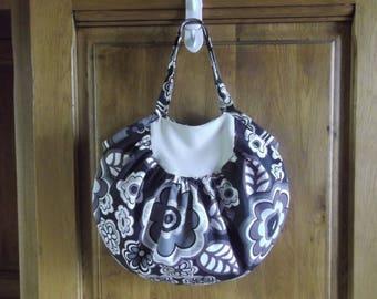 Reversible handbag with yokes and gathers.
