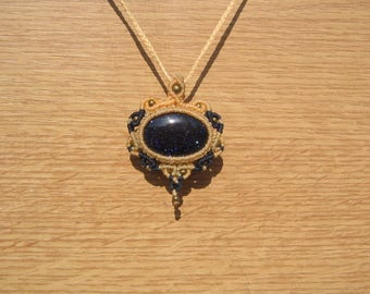 Necklace with a semi precious stone of the Sun