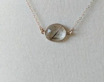 Rutilated quartz bezel pendant on sterling silver chain