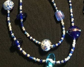 Multi hued blue and silver long beaded necklace