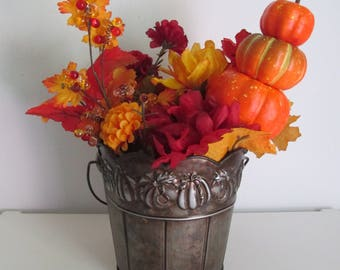 Autumn Themed Silk Flower Arrangement in a Metal, Pumpkin Embossed Pail, featuring Pumpkin and Beaded Picks