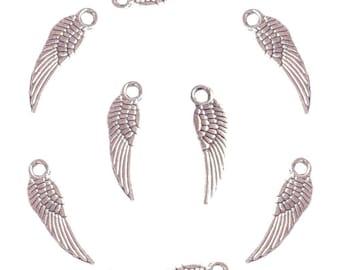 8 Tibetan silver wing charms