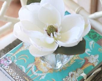 faux magnolia in square glass vase