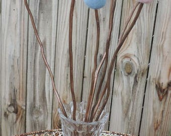 "loating Pink Blue Felted Flower Balls Glued onto Copper Rods in an Antique Glass Fostoria American Vase.  19 1/2"" Tall"