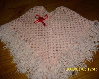 daughter 3/4 years with very light salmon crochet poncho