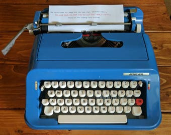 Bright blue 1970's Sears Achiever portable typewriter