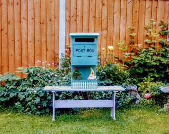 Wooden letterbox. Planter,garden ornament display