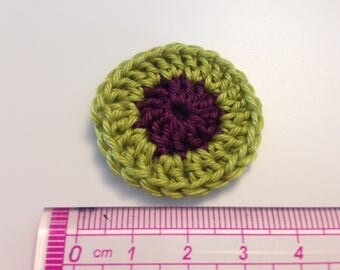 Rosette plum and green crocheted flower