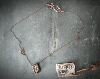 Caged herkimer diamond pendant.