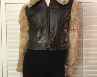 Leather jacket with fur trim