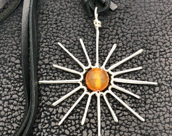 """Natural faceted round carnelian gemstone pendant.Hand wire wrapped """"Sun"""" necklace. Sterling silver wire  """"Pulsar"""" """"Sun"""" pendant"""