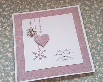 Handmade pink glitter pocketfold winter Wedding invitation, with snowflake and diamante embellishment
