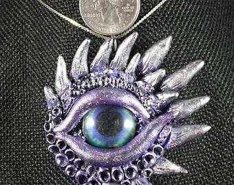 Black and purple dragons eye