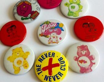 Vintage kids badges, 1970's ,1980's, care bears, Love is, Pooch, Never never club, little miss.