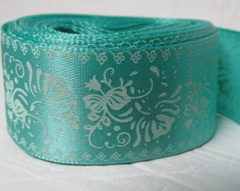 """Satin ribbon 1"""" white flowers on light green background sold by the yard"""