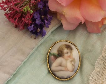 Antique hand painted cherub cameo brooch.
