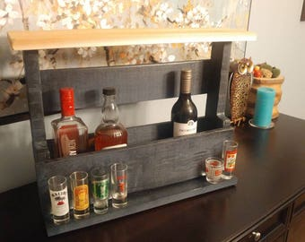 Wine and liquor holder with shot glass shelf. Made from pallet wood with cedar top.