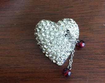 Rhinestone puffed heart pin.
