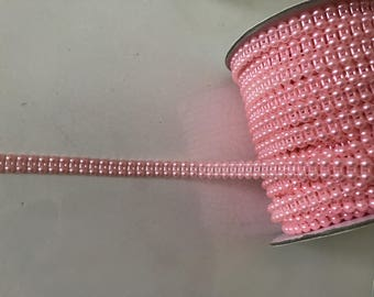 Bead 9mm wide ribbon has sewing in the middle or paste pink