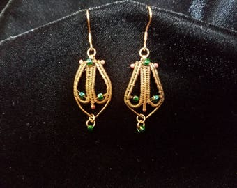 Copper wire wrapped earrings with emerald green glass beads.