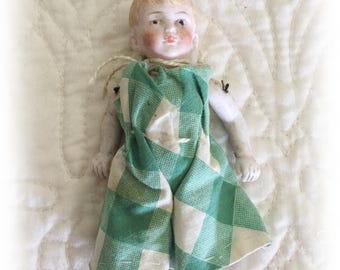 SALE! Antique, Victorian, late 1800s, early 1900s all Bisque doll with fixed hair and neck has movable arms and legs