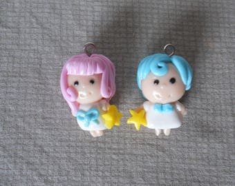 Two polymer clay pendants: couple of Angel holding a star