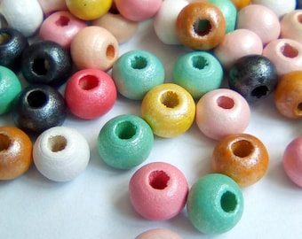 50 pastel wood beads round 6mm nipple clamps