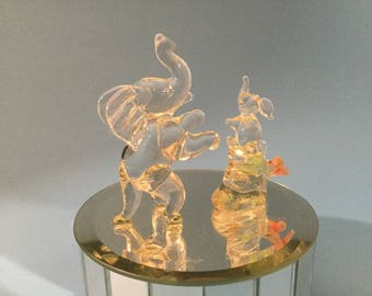 Blown Glass Elephants on A Wind up Musical Round Glass Base