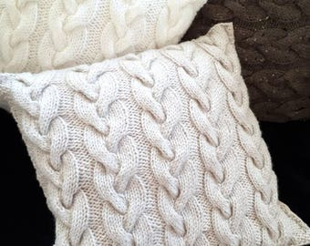 Cable handknit cushion cover.