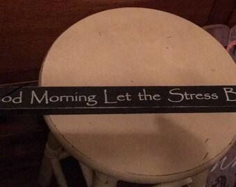"Sign ""Good Morning, Let the stress begin."""