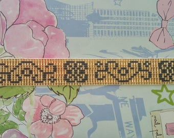 Bracelet weaved in gold and black Miyuki beads