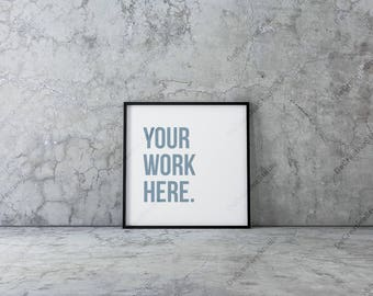 Square Poster Mockup with black frame Standing on concrete floor in empty interior
