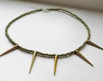 Golden spike statement necklace with adjustable length