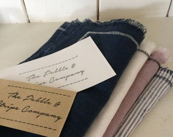 Set of 4 navy, pink, white and stripe linen napkins with navy stitch and frayed edge.