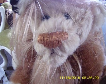 Caramel Carmel (winged soft sculpture lion) collectible artist sot sculpture made with both genuine furs an woven alpaca fur fabric.