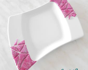 White ceramic plate decorated with Fimo