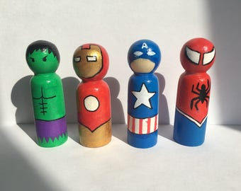 Four wooden, superhero peg dolls