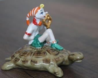 Porcelain figurine of Pinocchio on a turtle, Buratino, Golden Key