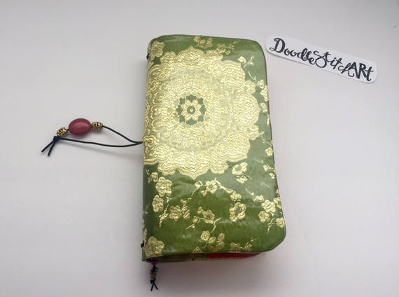 Handcrafted fabric journal with vinyl cover for use in planning, traveling, journaling, artwork, and more