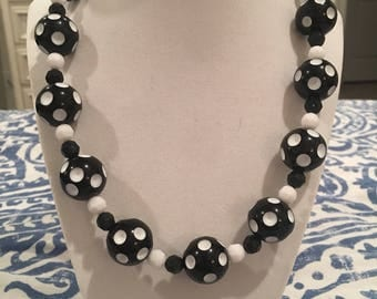 Black and white polka dot stretchy bubblegum Necklace .