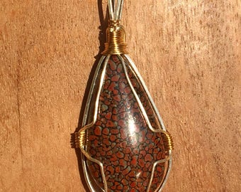 Agatized Dinosaur Bone  Cabochon Pendant Wire Wrapped in Silver with Brass.