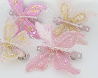 Pink butterfly barrettes