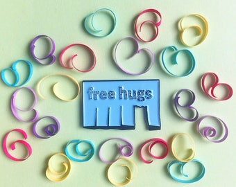 Soft enamel FREE HUGS pin