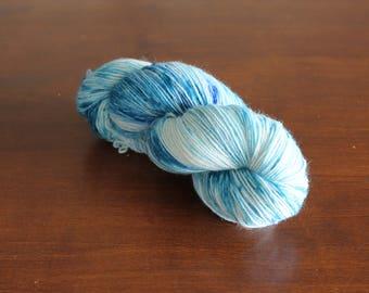 Handdyed yarn, sock yarn, fingering weight, yarn, socksanity, socksanity ymir, purple, blue, orange, yellow