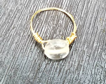 Clear stoned gold ring
