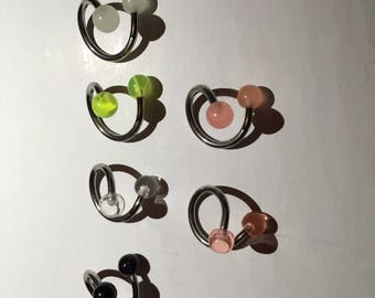 Pack of six alternative spiral belly rings with assorted ball colour