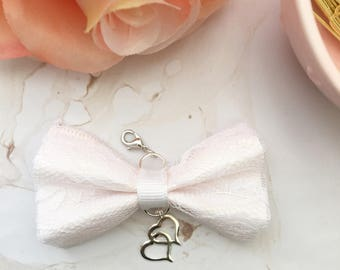 Light pink with white ribbon lace bow with silver hearts