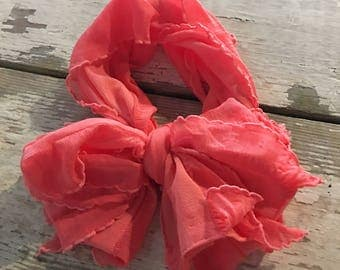 Bright coral messy bow