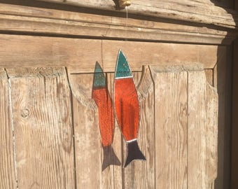 Sardine has orange tiffany stained glass hanging