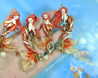Clown fish/ fimo necklace/ mermaids in polymer clay / fantasy clay
